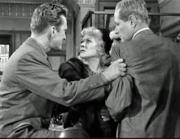 Strong-arming both witness (Gladys George) and perp (George McReady)